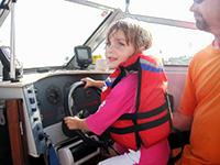 elizabeth & brooke driving boat